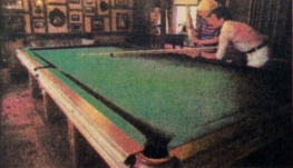 Couple enjoying their game on the full sized pool table - the 87 year old pool table being yet another recreational feature within Huntly lodge.