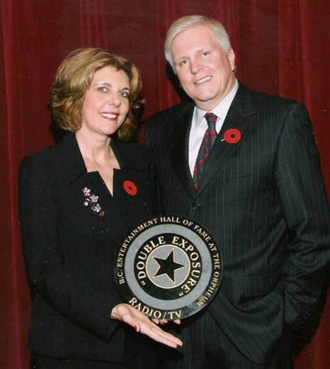Photo of Bob Robertson with wife Linda Cullen being recognized by the BC Entertainment Hall of Fame for their program Double Exposure.